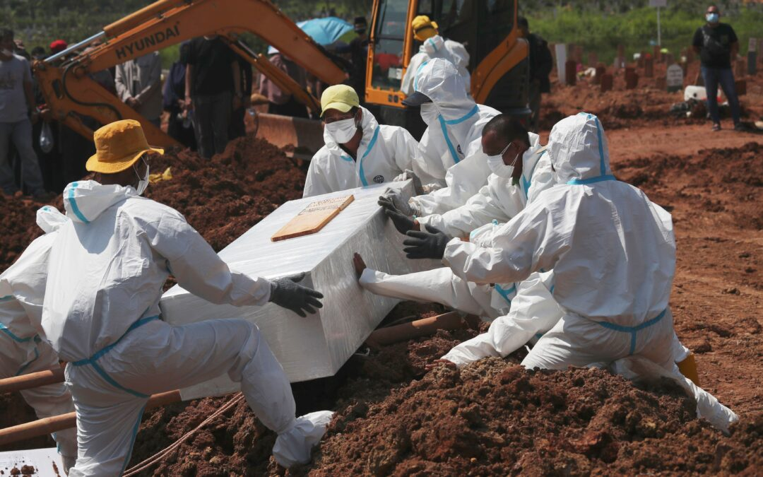 The Latest: WHO says coronavirus deaths up 21% in last week