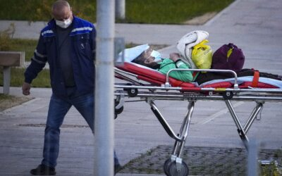 Russia marks pandemic's record of daily deaths, infections